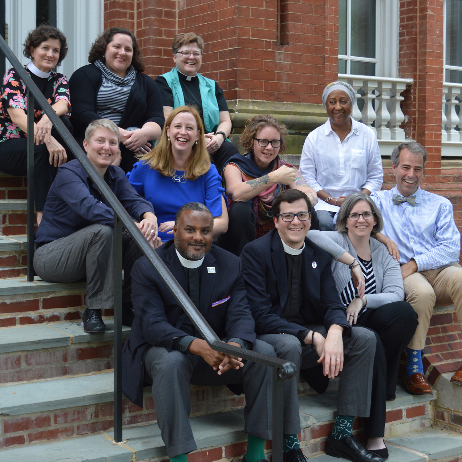 Masters Program - staff on stairs