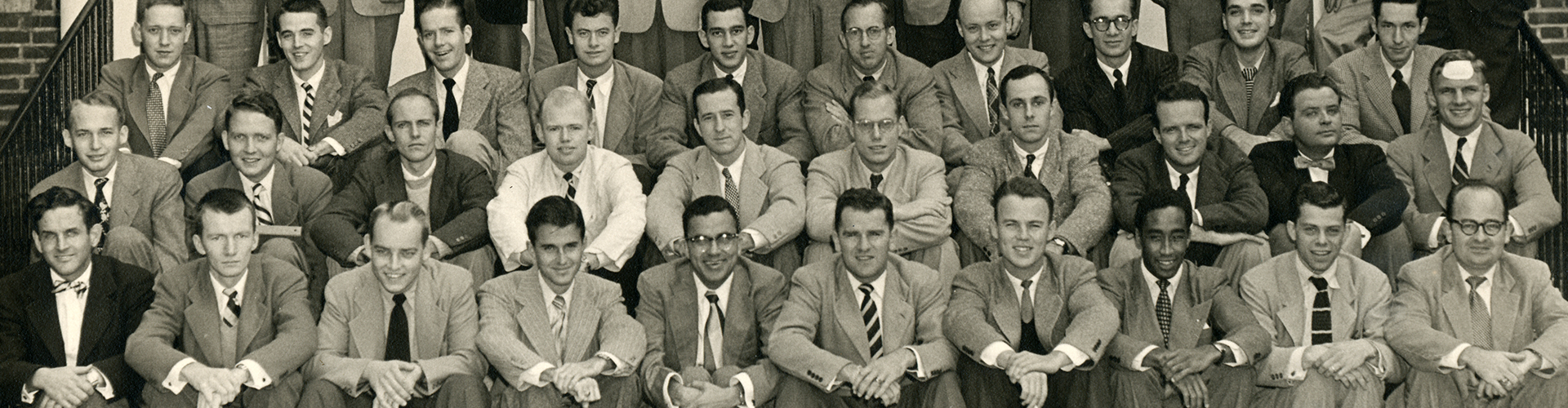 photo of group of men seated in rows from the archives