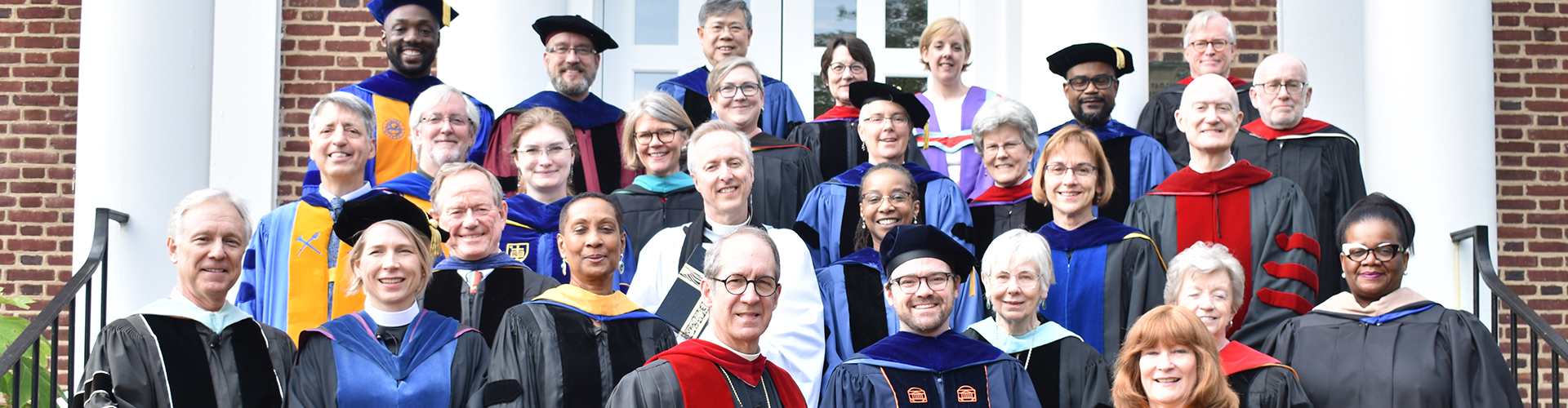 Faculty outside on stairs for group photo