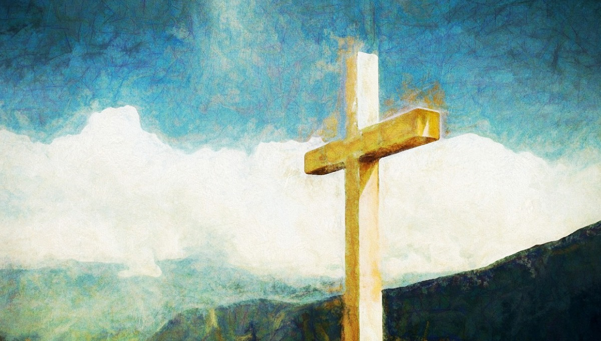 Watercolor image with a dark blue sky and a golden cross with landscape in the background